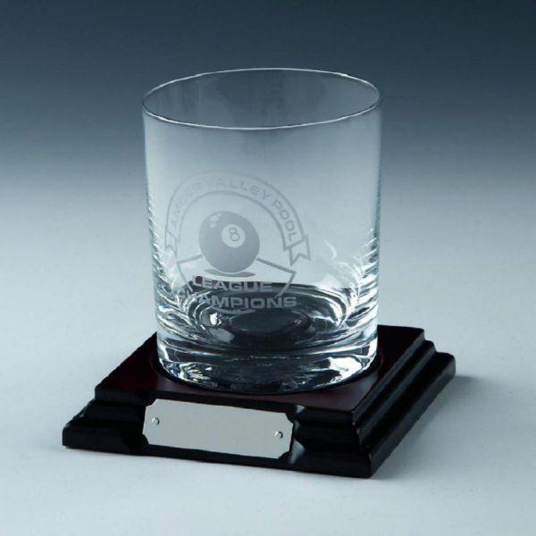 Single spirit glass on wood base