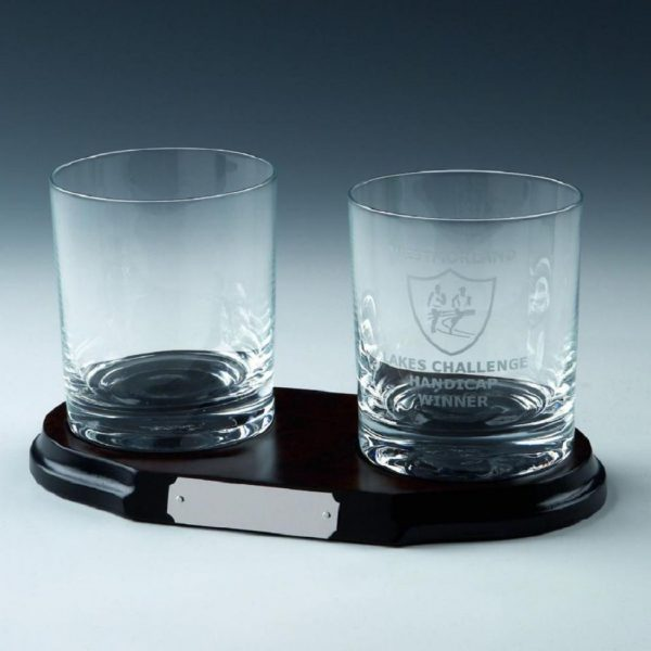 Two spirit glasses on wood base